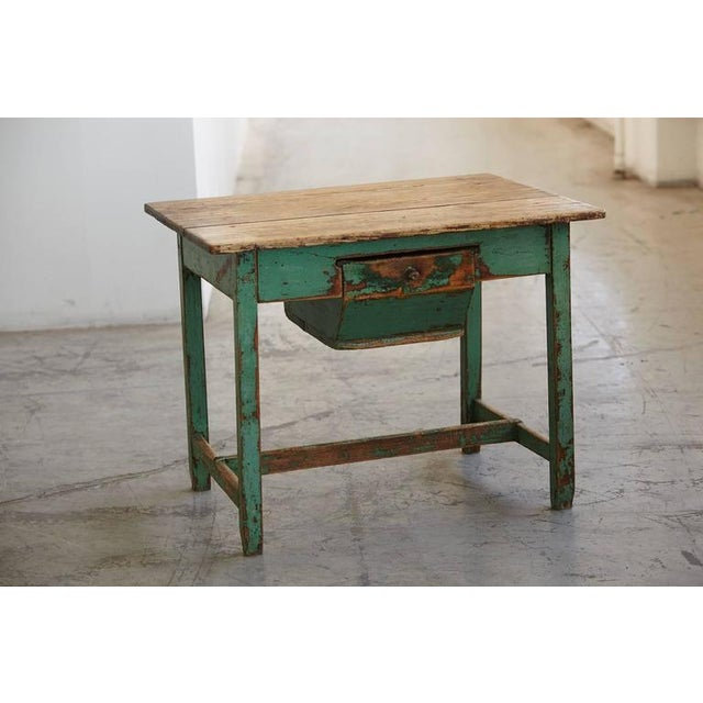 Primitive, painted pine dough farm table with large drawer. Authentic, distressed appearance with chipped paint. Solid and...