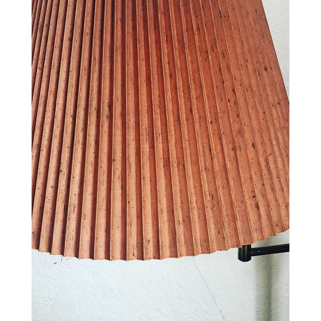 This pretty pleated lamp in a lovely terracotta color has a solid brass base with two different swivel parts. From the...
