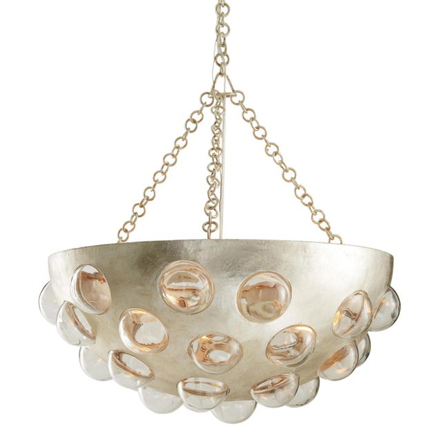 Stylish, modern, and futuristic, Arteriors Kendra Chandelier, iron bowl finished in a champagne leaf, glass bubbles and...