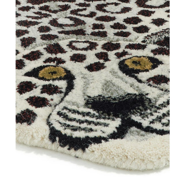 Bring some cheer to your room with this beautifully handmade Snowy Leopard Rug Large. The Snowy Leopard Rug Large is part...