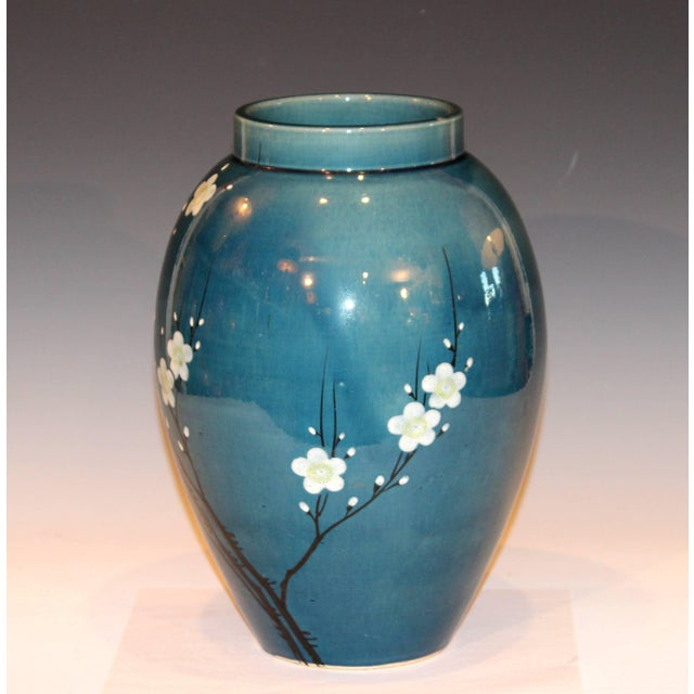 Large antique Awaji pottery vase with enameled prunus blossom decoration on a blue ground, circa 1910s. Impressed plover...
