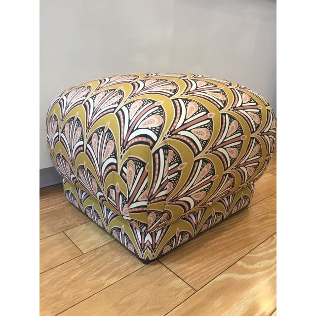 This ottoman has character to add to your room with a lot of comfort for your feet. Fabric upholstery is in a rich vibrant...