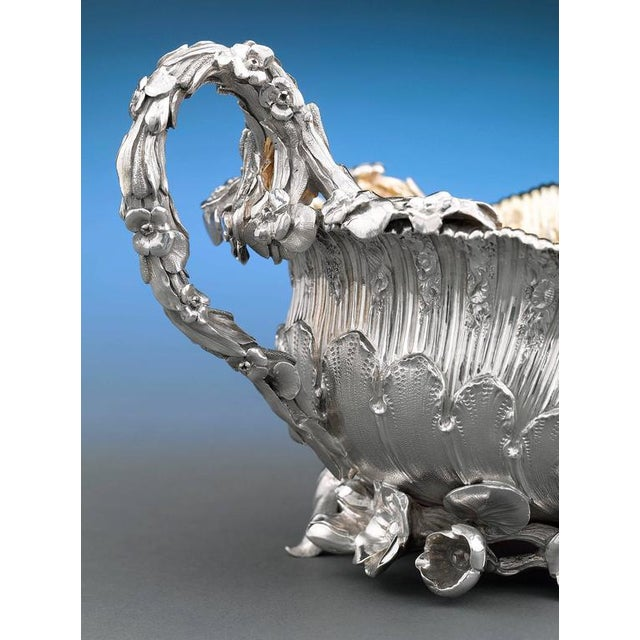 This exquisite George IV period silver sugar bowl by the celebrated Benjamin Smith is crafted in an exuberant Rococo...