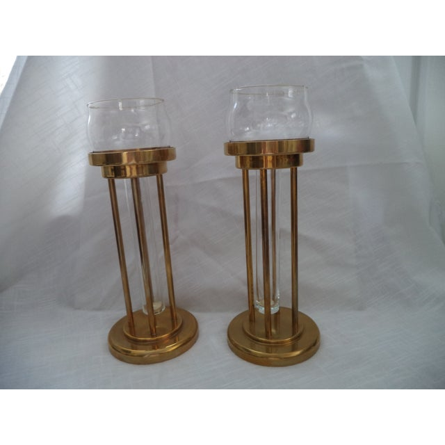 A beautiful tall pair of quality made candlestick holders, a three-part design. Made of heavy solid brass. Each is in...