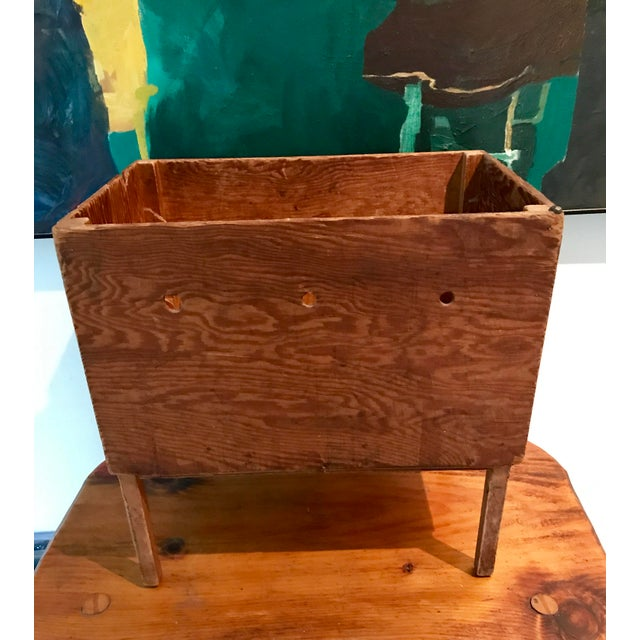 This antique bin was originally used for catching sloth as it rolled off a sewing machine or knitting needles. It's the...