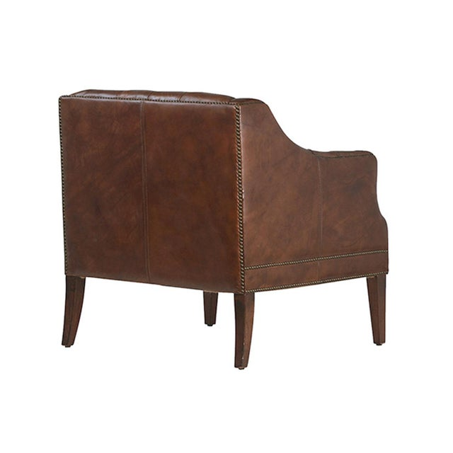 Aged brown 100% leather occasional chair with brass stud detail and a hardwood frame. This rich brown chair is...