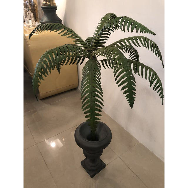 Vintage metal tole palm tree. Original finish may have some areas of patina. Heavy urn planter.