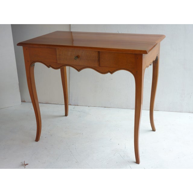 20th Century, blonde walnut Louis XV style end table with single dove-tailed drawer, well made with pegged construction.