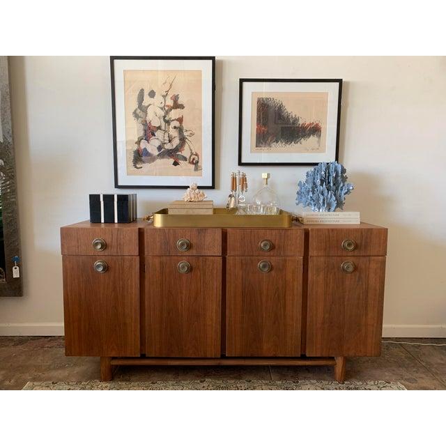 Pristine mid century American of Martinsville Credenza. Exceptional storage and craftsmanship.