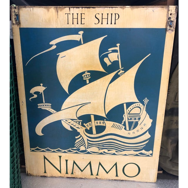 Lovely vintage double sided painted wood sign of the Ship Nimmo. Lovely patina. Would be a wonderful decor element in a...