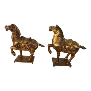Early 20th Century Tang Dynasty-Style Gilt War Horse Sculptures - a Pair For Sale