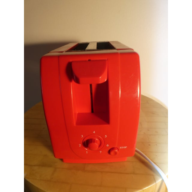 Simple red toaster over 10 years old. Only used once for testing purposes. In great condition.