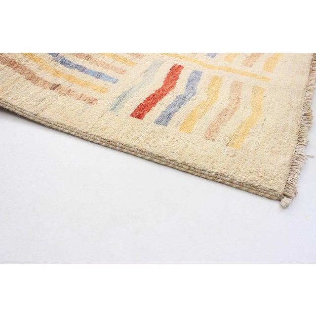 Type of Rug: Chobi Finest Country of Origin: Afghanistan Material: 100% Wool Style: Moroccan, Traditional Construction:...