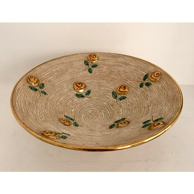 A very attractive and unique vintage Art Deco bowl with gold flowers. This piece is sure to bring charm to any space in...