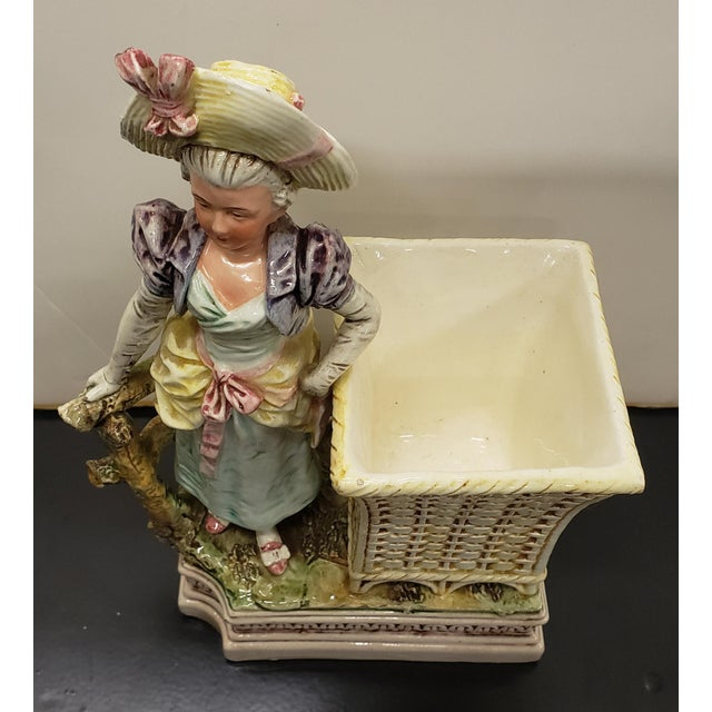 """Up for sale is a Late 19th Century French Majolica Porcelain Victorian Woman Matchstick Holder! It measures 9 1/8"""" tall...."""