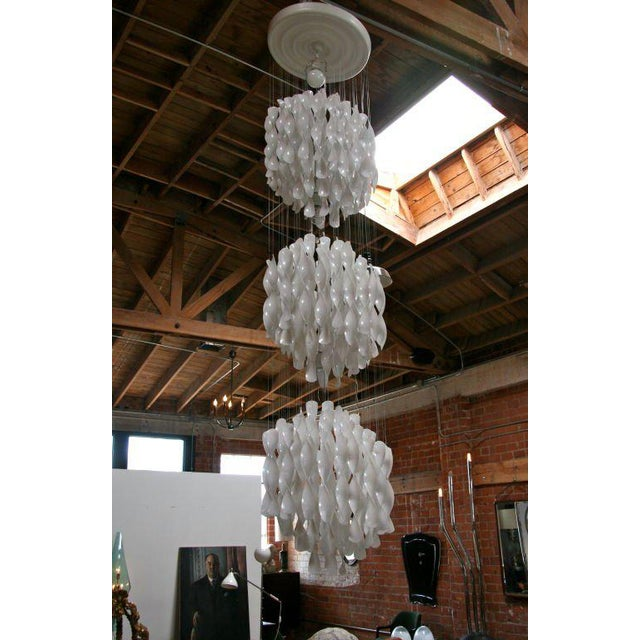 Round and round and round it goes. Make a statement with this cascading delight of white wavy wonder!