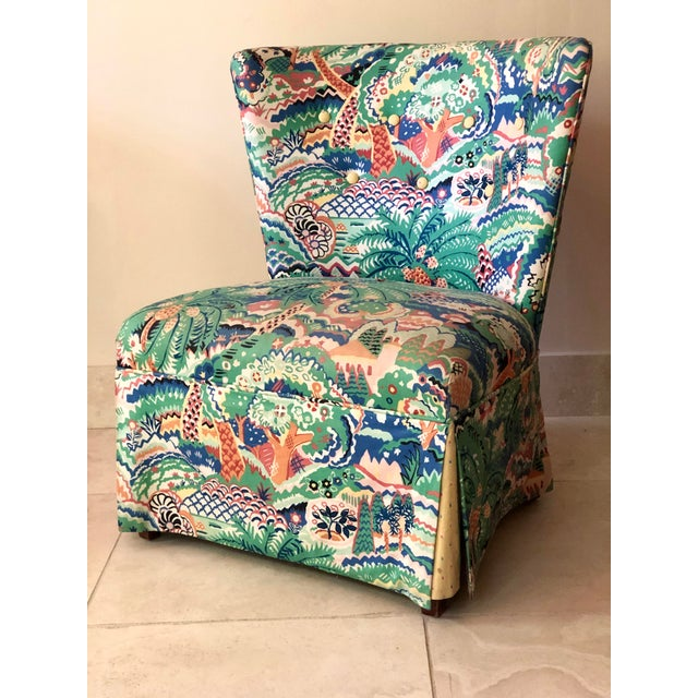 Adorable vanity or slipper chair upholstered in a fun tropical fabric and having a button tufted back, a tight seat, and a...