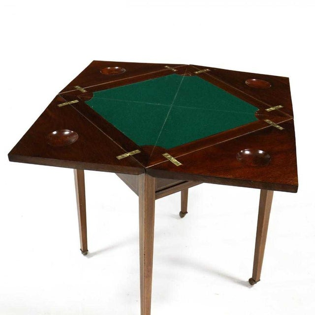 Edwardian inlaid mahogany handkerchief tTable circa 1900, swivel square top, with molded edge and banded inlay, four...