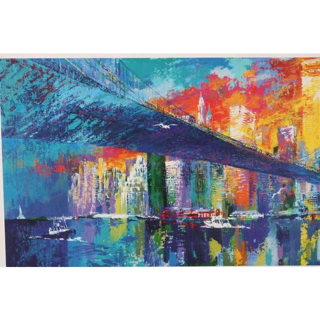 This signed lithograph by the American artist LeRoy Neiman captures the iconic Brooklyn bridge in a flurry of colors and...