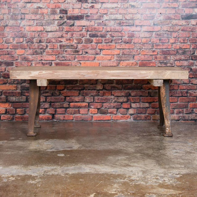 This impressive work table has a strong, rustic feel with it's substantial hard wood top that has been left unfinished...