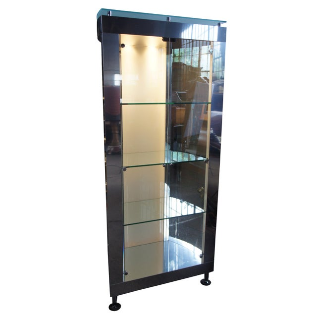 A gorgeous modern display cabinet. Believed to be Design Institute of America or Mastercraft. Circa 1990s. Finished in...