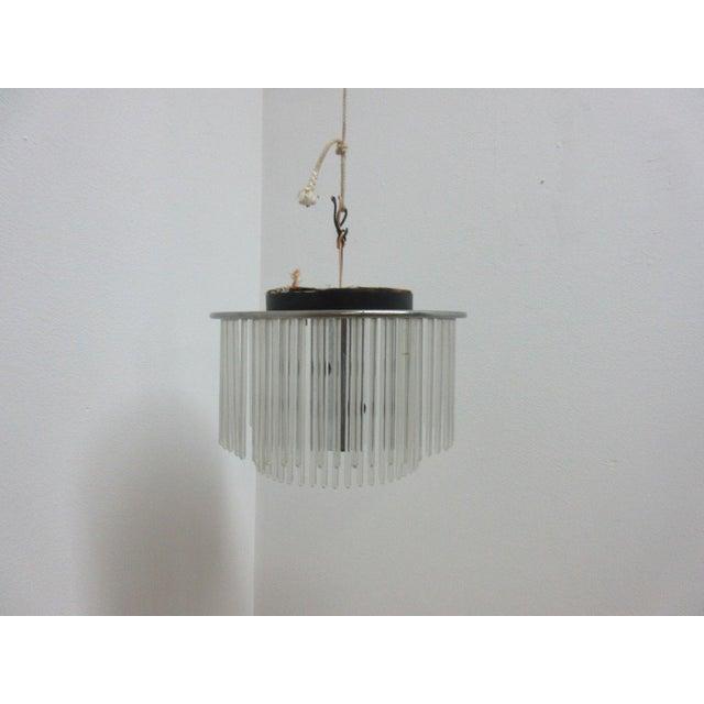 A Mid-Century Lightolier swizzle stick hanging chandelier. Measurements ( l x w x h) 12.5 X 12.5 X 8.75. Great shape....