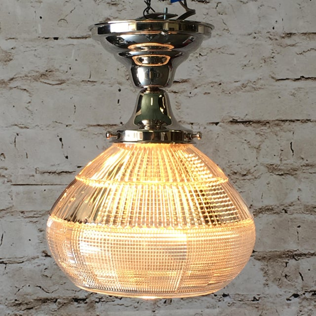 Nice art deco flush mount light with clear Holophane shade. Shade is original 1920s or 1930s with an open bottom. The...