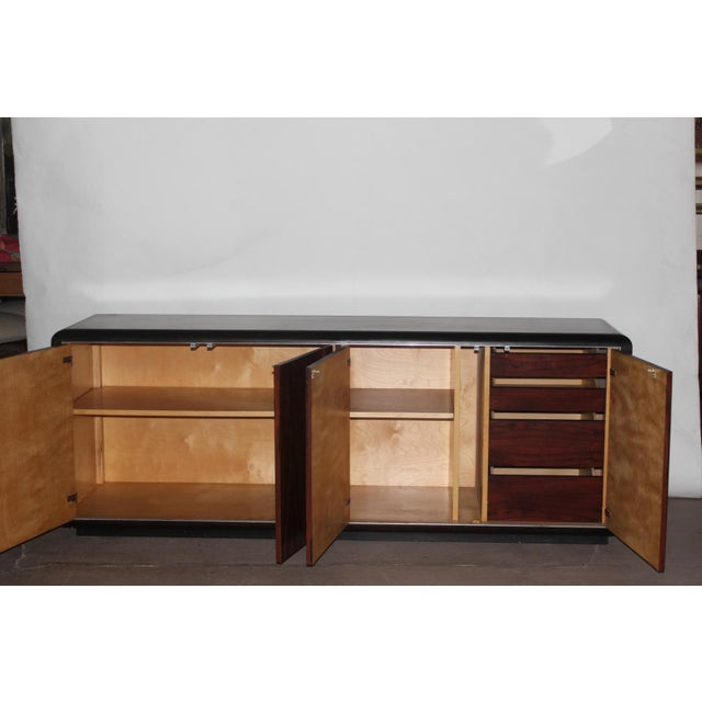 1970's ebony buffet with four doors, two shelves and six drawers. This piece is very versatile and can mix with a variety...