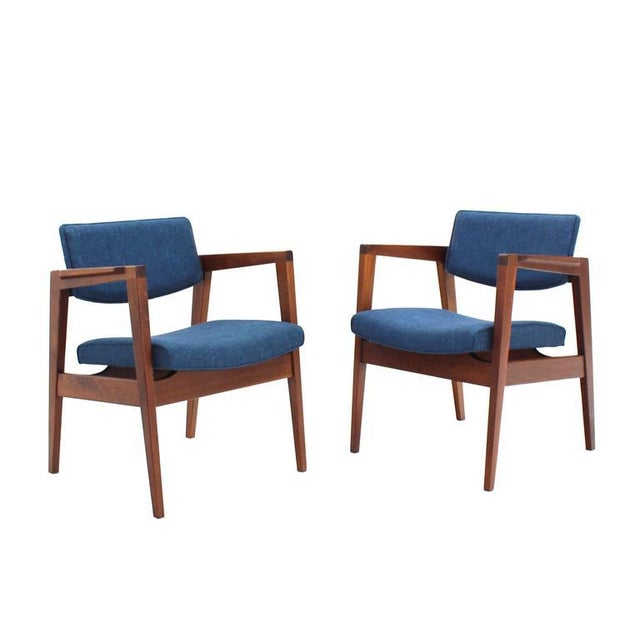 Very nice set of four Mid-Century modern newly upholstered solid walnut gunlock chairs.