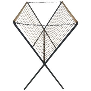 Modernist Tomado Iron and Jute Folding Magazine Rack For Sale