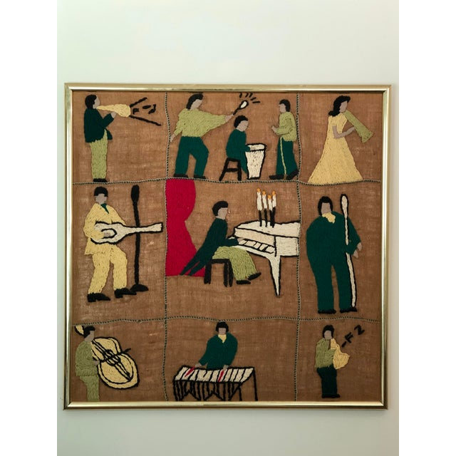 Fun and jazzy 20th Century piece of patchwork textile art featuring musicians playing instruments. Each square has figures...