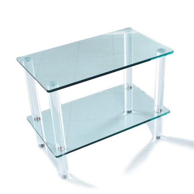 We're not sure who made this cocktail table, but it's very similar to works by Leon Rosen for Pace Collection. This...