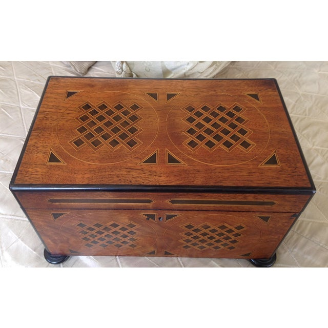 Beautifully crafted of English Walnut then intricately inlaid with graphicly- patterned marquetry. This tea chest was for...