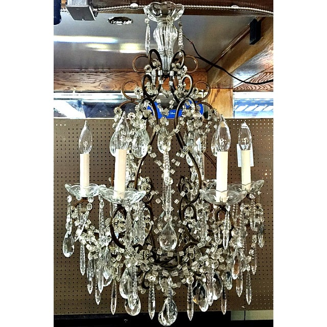 Pure elegance describes this vintage chandelier. It has six candle lights. Loaded with 13 rows of macaroni beads. Two...