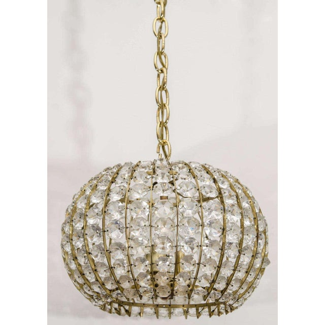 A lovely Austrian globe with a brass frame and faceted crystal beads, perfect for a small space or powder room.
