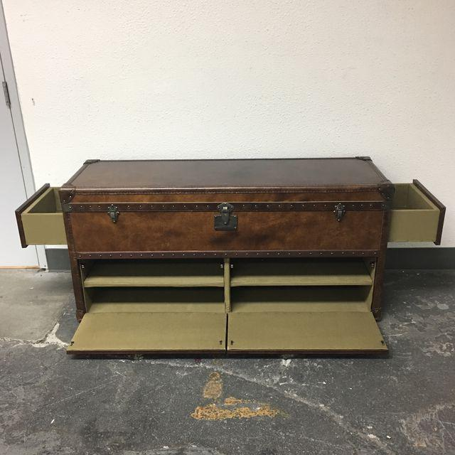 Design Plus Gallery has a Restoration Hardware May Fair Steamer Trunk. This beautiful leather covered trunk has been made...