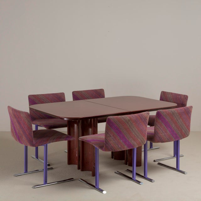 A Saporiti designed cerused wood extendable dining table 1990s. Centre leaf is 60cm. NB: These items are subject to a...