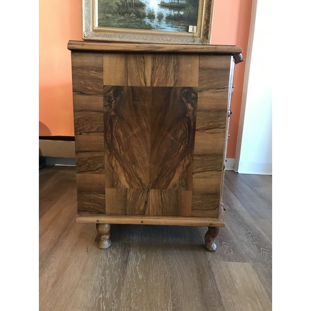 Fabulous Italian chest of drawers, dating back to the late 1700s. Gorgeous burl walnut featuring substantial and handsome...