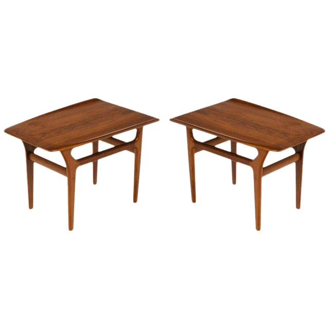 Pair of teak Mid-Century Modern end tables with streamline design, in the style of Poul Jensen. Fabulous sleek angles...