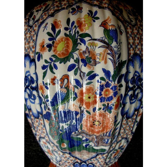 Mid 19th Century A Massive Dutch Polychromed Tinglazed Delftware Lobed Urn With Lid Surmounted by a Regal Lion For Sale - Image 5 of 7