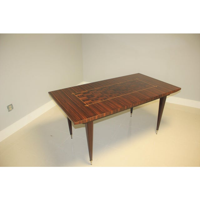 Classic French art deco exotic macassar ebony dining table or writing desks, circa 1940. Solid ebony wood legs with brass...