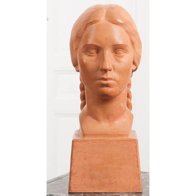 A distinguished terra cotta bust from the early part of the 20th century. Made in France, the work depicts a female with...