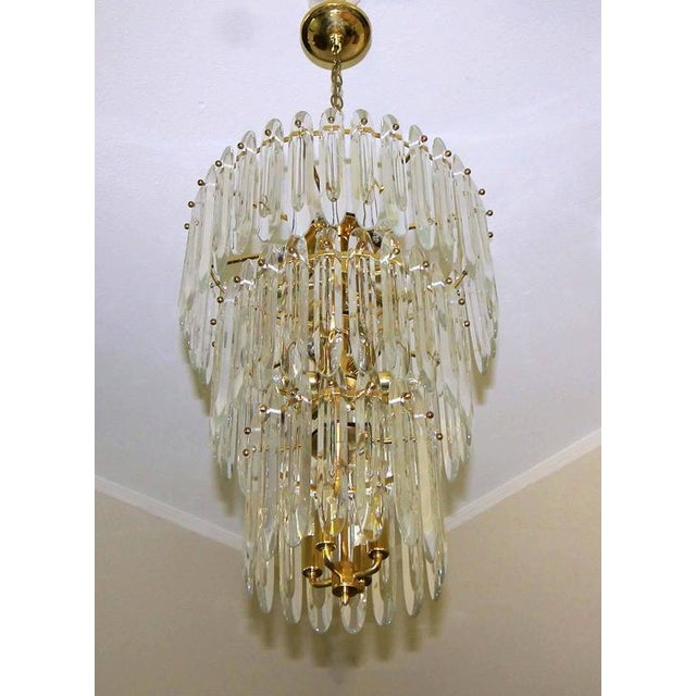 Large and impressive three-tier crystal 18 light chandelier by Gaetano Sciolari. Gorgeous shaped crystals on brass plated...