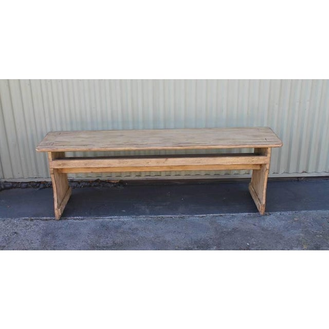 This 19th century cream painted bench has mortised leg construction and square nails. The front rail is also mortised and...