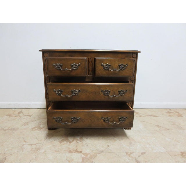 A Baker carved dresser. Great shape, tight and sturdy. Light wear.