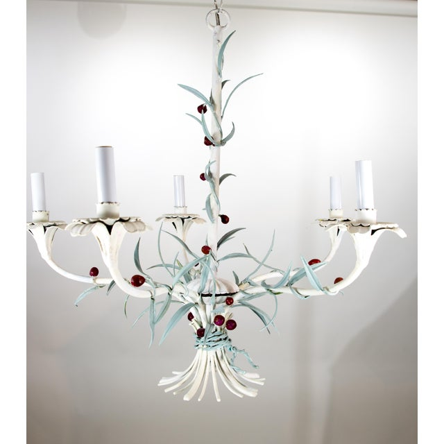 A charming mid-century Italian tole foliate chandelier with 5 candelabra lights. working wired, however wire is old....