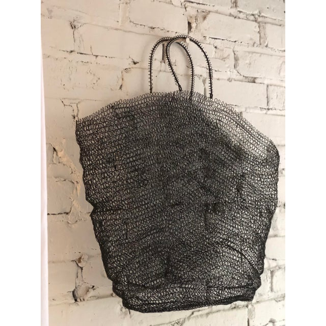 Amazing handmade sculptural wire art bag that could be used as wall art, a basket, a magazine holder, or as a handbag. So...