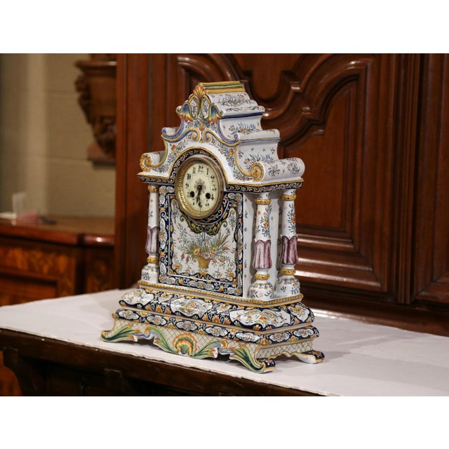 This elegant and colorful clock was crafted in Normandy, France, circa 1870. The antique, ceramic, mantel clock sits on...