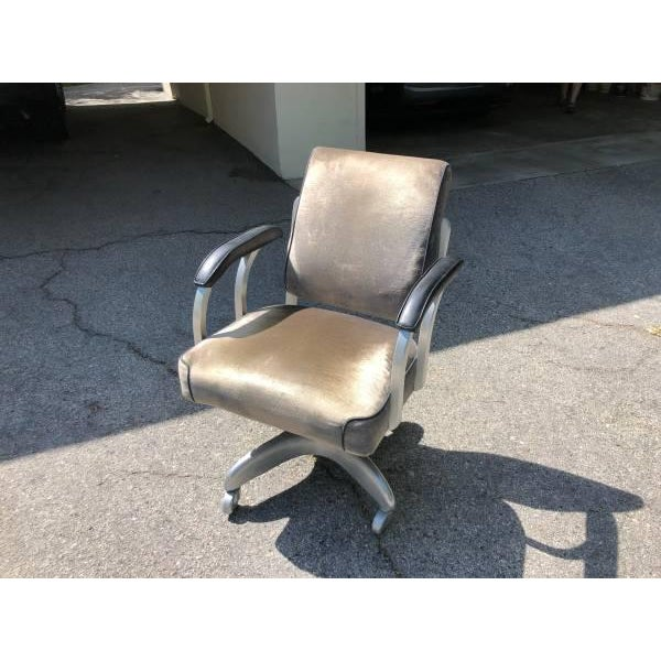 Classic Emeco swivel desk chair, grey valour upholstery, on original casters. Excellent condition.