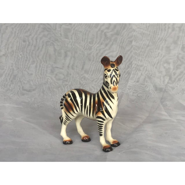 Made in Japan, this mid-century modern ceramic zebra figurine will add a safari adventure touch to your home decor. The...